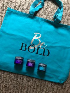 Lanc me bag and 3 products