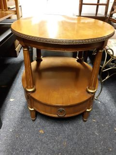 Antique oval side table with drawer at bottom
