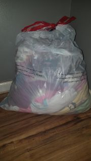 Full trash bag of 6-9 month winter clothes
