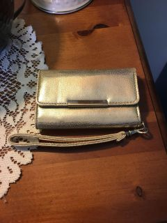 Small gold wallet never used