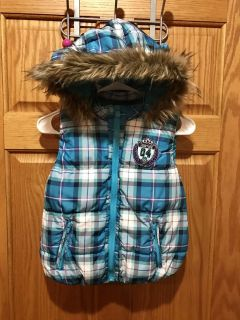 Justice Turquoise Blue/Purple/White Plaid Puffy Vest with Detachable Hood. Two front zipper pockets. Size 10. Adorable!