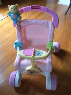 Fisher Price Musical Stroller/Walker. Great shape with brand new batteries ($5 alone). PPU in Mansker Farms.