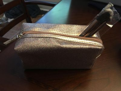 Gold sparkly make-up bag and brushes new.