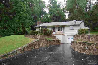 136 Sweet Hollow Rd Milford Three BR, nestled above the road very