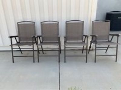 2 sets of 4 folding chairs