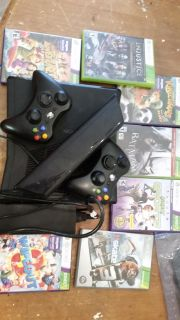 Xbox 360 w/Kinect, 2 wireless contollers, power bar, and games