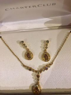 Set in Gold toned with brown and white crystals