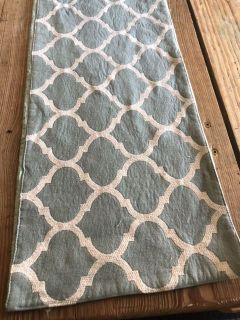 Teal and white table runner.