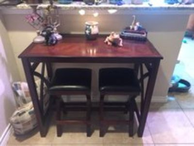 Side bar table with stools