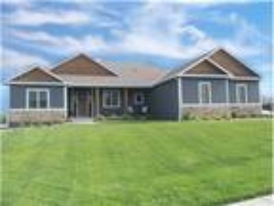 Spacious and Open Walk-out Ranch Blocks from Rock Chalk Park!