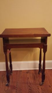 Antique wooden desk with wheels