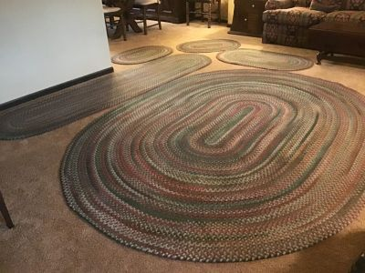 9x7 oval braided rug with four matching rugs