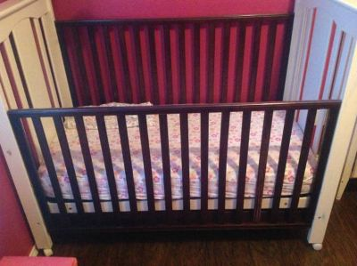 Crib black and  brown mattress
