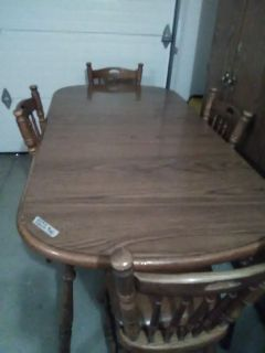 Wooden table and four chairs.