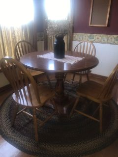 Solid maple round dining table and chairs.