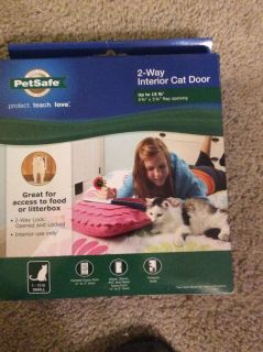 NIB Indoor 2-way Interior Cat Door. I purchased for my cat. It was never installed. See photos for size, weight, etc