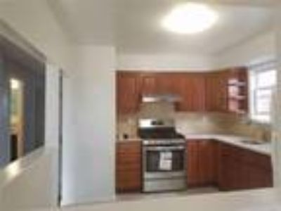 Real Estate Rental - Three BR, Two BA Apartment in bldg