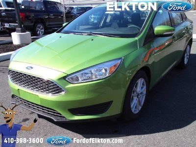 2018 Ford Focus SE (Outrageous Green Metallic Tinted Clearco)
