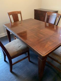 Dining room table with six chairs buffet table and leaf