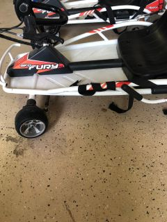 Razor fury electric go carts in used condition. Seat belts messed up and one gear is backwards. Have charger. Work good.