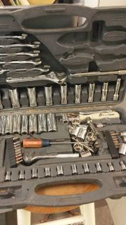 Box of used wrenches