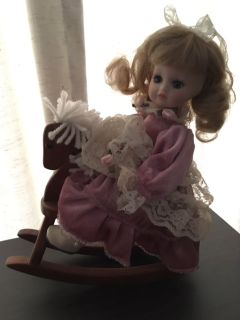 Porcelain doll on horse