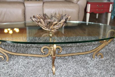 Glass table with ornate gold legs