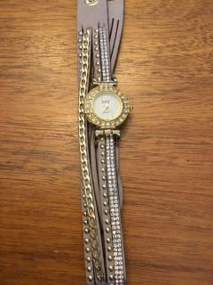 Wrap watch with beige strap and gold trim, new