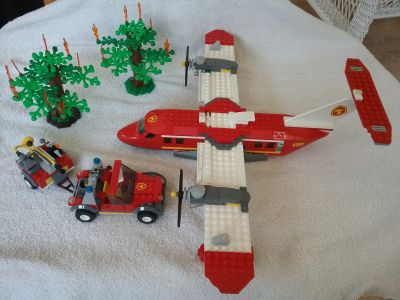 Lego fire plane, burning trees and Jeep with trailer.