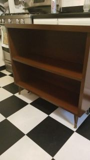 Vintage bookcase with feet