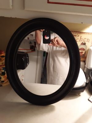 Pretty black wooden mirror beautiful trim see close up