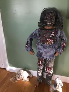 Zombie Halloween costume that scares the puppies. Fits 10/12 yrs old