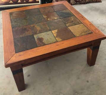 American Signature furniture. Solid wood / rustic slate tile top coffee table and two end tables.