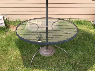 Glass round table with umbrella only.