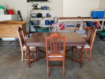 Antique solid wood dining room table with 5 chairs
