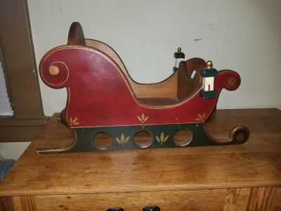 """Real wood Christmas sleigh 25"""" long x 10.5"""" wide x 15"""" to the highest point"""