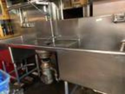 Commercial restaurant sink and vent hood