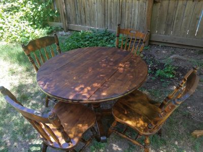 Solid oak drop leaf dining table and set of 4 chairs