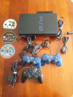 PlayStation 2 with all the connections and 3 games