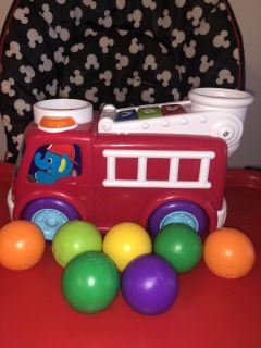 Bright starts fire truck with balls that pop out