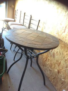 Tile table with 4 chairs and baker s rack