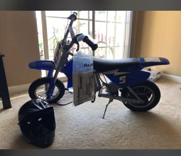 Razor Electric dirt bike with helmet and papers about a year old and stored inside