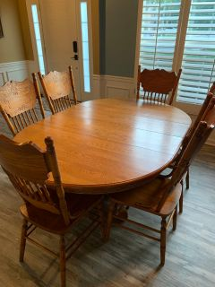 Dining Table with 2 removable leaves and 6 chairs.