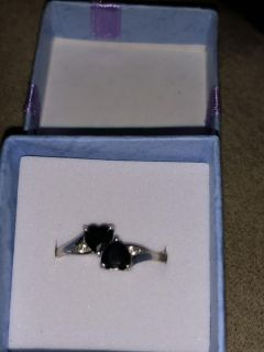 Sterling silver ring with two black heart stones