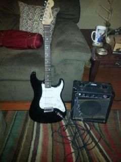 Fender electric guitar, cord and Gorilla practice amp