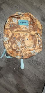 Backpack regular size, there is no holes just minor stain on the inside,