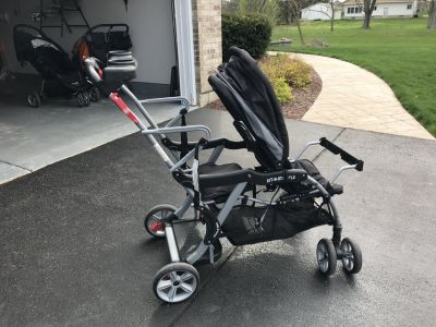 Double sit and stand stroller