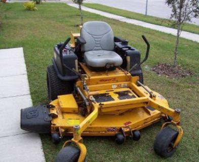$2240 excellent Lawn Mower Super Z with 66 inch XR7 deck