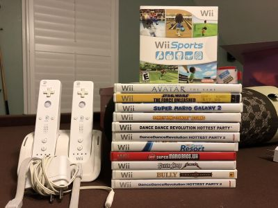 Wii remotes with charging station and variety of games