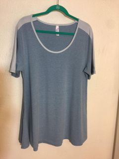 Lularoe perfect t..pre-owned in euc.. size large.. solid blue and sleeves lined in light blue